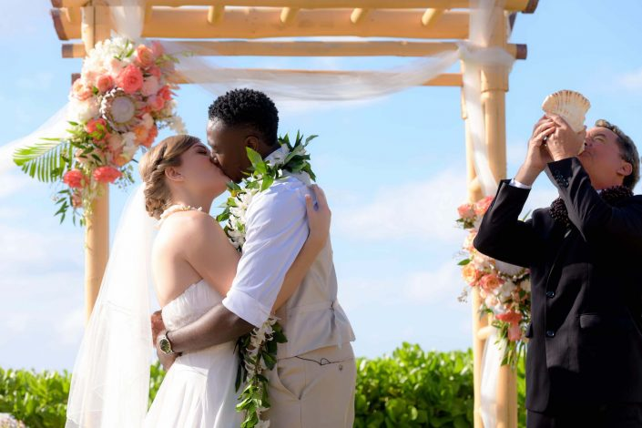 Oahu Wedding Photography - First Kiss at Paradise Cove Ceremony. Photo by Mayberry Multimedia
