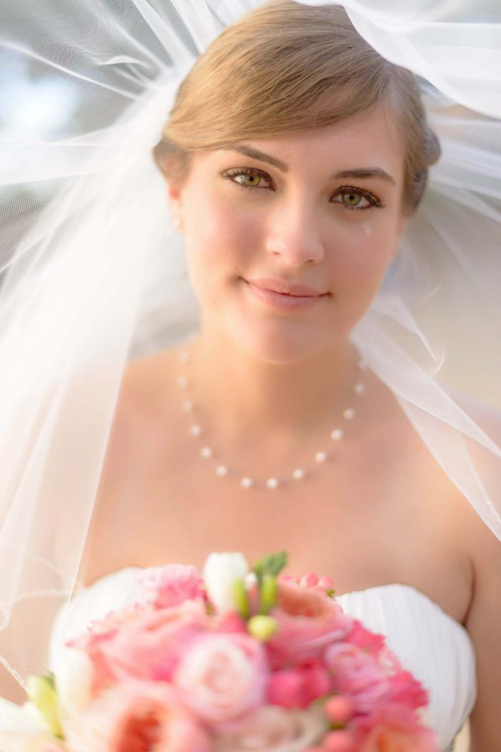 Wedding Photography Bridal Portraits at Paradise Cove, Hawaii. Photo by Mayberry Multimedia