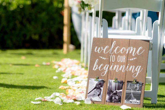 Wedding Ceremony at Paradise Cove, Oahu, Hawaii. Wedding Signage. Beach Wedding Photography. Photo by Mayberry Multimedia
