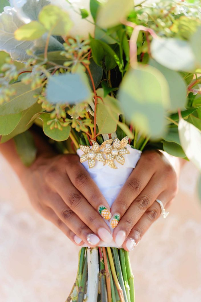 Bouquet and nails - Destination Wedding in Hawaii at the Hawaii Polo Club on Oahu's North Shore. Photo by Mayberry Multimedia