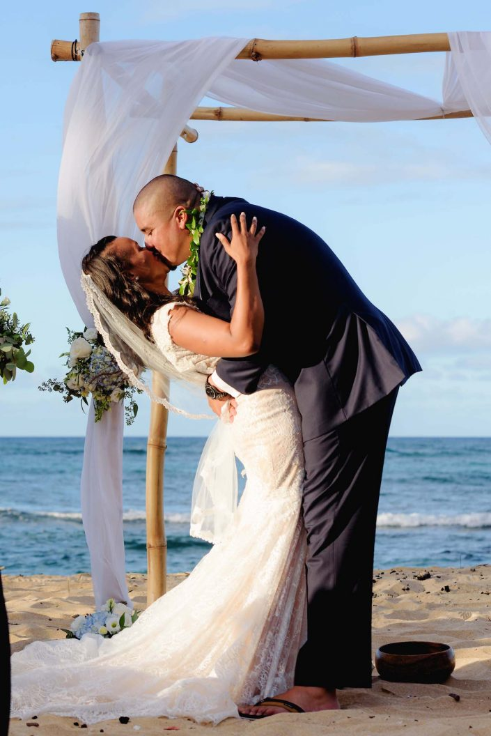 First Kiss at Destination Wedding in Hawaii at the Hawaii Polo Club on Oahu's North Shore. Photo by Mayberry Multimedia