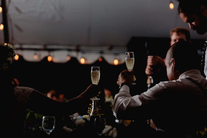 Toasts at Destination Wedding in Hawaii at the Hawaii Polo Club on Oahu's North Shore. Photo by Mayberry Multimedia
